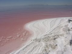 """""""Pink curve along the Spiral Jetty, the Great Salt Lake, Utah. Robert Smithson's famous earthwork Spiral Jetty is located in the north arm on the Great Salt Lake in Utah. Using black basalt rocks and. Robert Smithson, Basalt Rock, A Well Traveled Woman, Red Water, Neon Genesis Evangelion, White Photography, Photography Women, Travel Photography, Beautiful Places"""