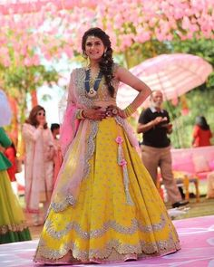 "Reposting Choose bright and unconventional colours for your mehendi and sangeet outfits to add that ""Hat-ke"" element to your look. Outfit and picture by Bridal Mehndi Dresses, Indian Bridal Outfits, Indian Bridal Lehenga, Indian Gowns, Indian Designer Outfits, Indian Wear, Half Saree Lehenga, Lehnga Dress, Anarkali"