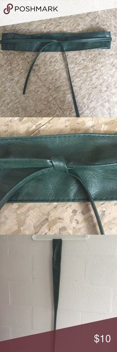 """Green Obi Belt Cute and versatile dark green faux-leather obi belt. Last picture shows different ways you can wear it. Excellent condition, only worn once. Measures 84"""" long and 2.5"""" at widest part. Accessories Belts"""