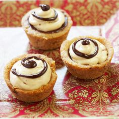 These holiday cookies taste as great as they look. These crisp cookie shells are filled with a mixture of whipped cream, peanut butter, and cream cheese-with chocolate both below and above.