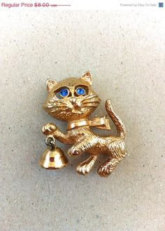 1970s Avon Rhinestone Eyes Kitty Cat Brooch