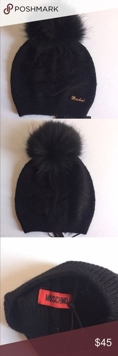 Moschino Heart Wool Hat with Raccoon fur Pom NEW New with tags Moschino wool hat with Raccoon fur Pom. Heart pattern. Color - black. The Pom is detachable. Material: wool blend. One size. Made in Italy. PLEASE DON'T OFFER 30-35$ - I WILL NOT SELL. Moschino Accessories Hats