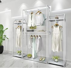 Online Shop Golden clothing store rundown table decoration window bag display rack in the island display table cabinet high and low table. Boutique Interior, Clothing Store Interior, Clothing Store Displays, Hanging Clothes Racks, Clothes Shelves, Womens Clothing Stores, Women's Clothing, Clothes For Women, Bag Display