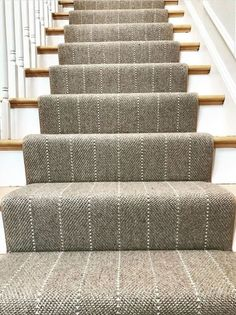 Love the modern design of this carpet runner. It is unique and gives the staircase a custom look. The light color carpet is also beautiful next to the white on the staircase. White Staircase, Staircase Runner, Staircase Design, Staircase Ideas, Carpet Runner On Stairs, Best Carpet For Stairs, Runners For Stairs, Pattern Carpet On Stairs, Navy Stair Runner