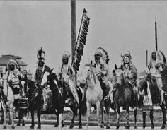L-R: Duck Chief Siksika, Heavy Head Kainai, Bob Riding Black Horses Kainai, Cross Child Kainai, unidentified, Gets Lots Of Wood At Night ,Kainai