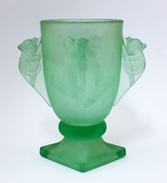 Opaque green Depression glass, Art Deco glass vase with koalas on the body and a pair of koala shaped handles