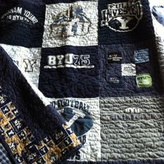 Tip: iron on fusible webbing before you cut your square and your t-shirt won't stretch out of proportion. TShirts and sweatshirts were used even small patches were made intro the nine patch alternating block. Probably the cheapest quilt I've made!!!