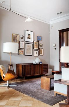 Lovely rosewood credenza, leather Swan chair with patina, art wall, and that floor!! //Eclecticity// Interiors | Brooklyn Brownstone - DustJacket Attic