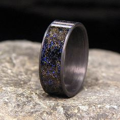 Blue Twilight Gibeon Meteorite Shavings Inlay Carbon Fiber Wedding Band or Ring by HolzRingShop on Etsy https://www.etsy.com/listing/201881042/blue-twilight-gibeon-meteorite-shavings