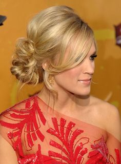 I love this side messy bun with a side swept bang. Again, one of the most versatile hair styles out there.