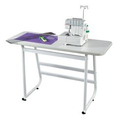 The Janome side table or craft table can work with your Universal Table or on its own to hold your serger or cutting projects.
