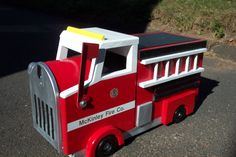 Firetruck mailbox, local fire companies' logo can be added to each side. Great gift. Check out Daves Custom Built Mailboxes
