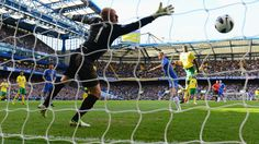 Fernando Torres of Chelsea (9) beats goalkeeper John Ruddy of Norwich City to score their first goal during their English Premier League match. Chelsea 4-1 Norwich. [ http://www.uefa.com/teamsandplayers/teams/club=52914/domestic/photos/photo.html ]