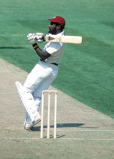 "Sir Isaac Vivian Alexander ""Viv"" Richards - Voted one of the Five Greatest Cricketers of the Twentieth Century, Sir Viv played 151 Test Matches for the West Indies during their golden era from 1974 to Test Cricket, Cricket Bat, Cricket Sport, Viv Richards, Cricket Wallpapers, World Cricket, Sport Photography, Sports Pictures, Sports Stars"