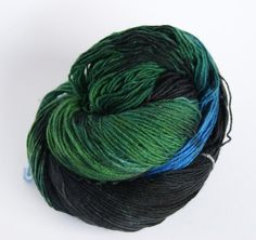 Handpainted Yarn Fingering in black green blue by camgarn on Etsy