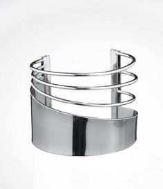 My cut-out cuff I got at Express...a great go-to for jazzing up a plain sweater or with a three-quarter sleeved blazer.