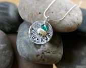 Sterling silver 2-sided hand-stamped and hand-distressed 3/4 inch round pendant with a birthstone drop bead. The back can be handstamped with birth dates or words. All pendants are on a .7mm sterling silver chain with a lobster clasp. $45. Check it out on FB at DesignSmith.