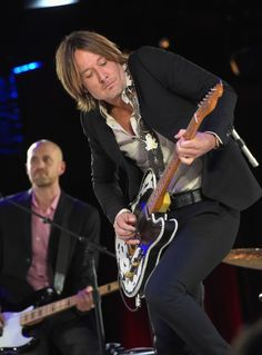 Get down, man, get down. Keith Urban turns up during a performance at the 2014 BMI Country Awards at BMI offices on Nov. 4, 2014 in Nashville, Tenn.