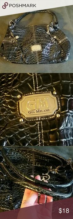 NWOT!!! Gia Milani shoulder bag! This is in like new condition, carried only once! Absolutely no flaws of any kind, no stains, or rips, Etc. I'm open to offers and bundle under 5 lb. Posh double dips and if the label of graded needed I get charged the entire shipping amount as well as the buyer getting charged the normal rate. No trains, smoke-free, and Pub friendly. Typically ship same or next day Gia Milani Bags Shoulder Bags