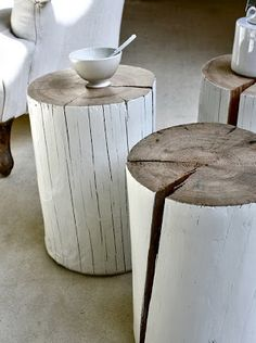 wood rounds painted white & used as end tables