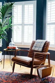 We're a big fan of this Room and Board armchair. The leather upholstery with a mid-century modern wooden frame is simply elegant.