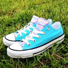 Aqua blue Converse with a striped tongue in pastel colors.