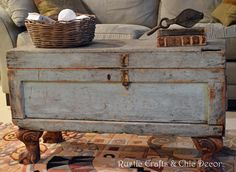This trunk table was made from an old army foot locker!  It was styled up by just adding clawfoot legs and a little paint. (Idea, not a how-to)