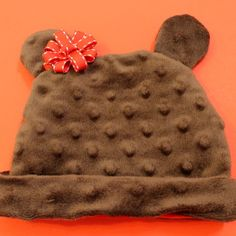 It doesn't happen very often, but sometimes I see an idea or a tutorial on a blog and I have to make it NOW. This was the case with this Bear-y Cute hat tutorial by Jessica at Happy Together. Not only was the cuteness factor through the roof, but it also seemed totally doable for my sewing...