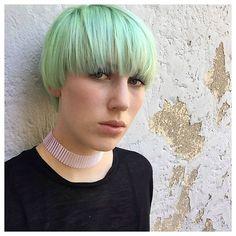 Pastel mint green bowl cut by Aveda Artist Nadina Thelen of Germany. Formula: Bleached pale yellow base. Toner: 10g 0n+10g ELC + 1g PP green + 2g PP yellow + .5g PP blue + 40g liquid.