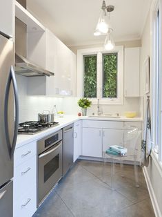 L Shaped Kitchen Designs with Beautiful Design: Contemporary Small L Shaped Kitchen Design With White Kitchen Cabinet And Drawers Color Also Stainless Cooker Also Gray Tile Flooring Also Adorable Pendant Lights With Cone Shaped Also Admirable Acrylic Chair ~ kitchentablecomics.com Kitchen Ideas Inspiration