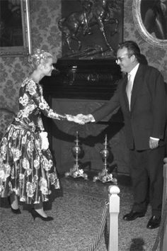 Grace Kelly and Prince Rainier III of Monaco when they met. The future Princes saluting the Prince.