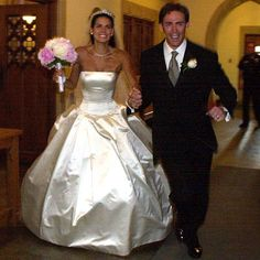 Law & Order star Angie Harmon and New York Giants player Jason Sehorn were married on June 9, 2001 in Dallas, Texas. The bride wore a strapless satin Vera Wang gown and Neil Lane antique tiara and carried a bouquet of pink peonies. Vera Wang gowns are sold at The Bridal Salon at Saks Jandel.