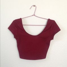 PacSun Maroon Lowback Crop Top This is a super cute top from PacSun (brand is LA Hearts). A great staple piece that can be worn from summer with high waisted shorts into fall with cute tights and skirts. It's been worn multiple times but I can't find any flaws, so be assured it's great quality! It's a true XS PacSun Tops Crop Tops