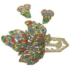 Little Nemo's Art Deco signed LN / 25 jewel-tone rhinestone pin clip with its matching earrings are being offered for your consideration. The set is