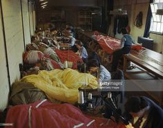 COLOR FILM!!! Women At War 1939 - 1945, Women's Auxiliary Air Force: WAAF personnel on an RAF glider station in Britain repair and pack coloured parachutes for use by airborne troops during the Normandy invasion, 31 May 1944.