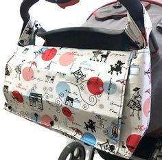 Wheelchair Bag - Stroller Caddy - Stroller Bag - Pram Caddy - Pram Bag - Messenger Diaper Bag - Convertible Diaper Bag - Diaper Bag by LilBayouBoutique on Etsy Stroller Bag, Umbrella Stroller, Convertible Diaper Bag, Messenger Diaper Bags, Cycling Backpack, Large Diaper Bags, Bicycle Bag, Holding Baby, Practical Gifts