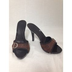 Every girl needs a classic pair of sandals in her closet to dress up just about any look. These Christian Dior Crocodile brown leather D Sta...