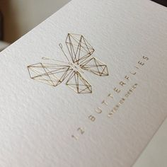 12 Butterflies by Candyblack Studio...One of my favorite logos!  You can't go wrong with gold on white!