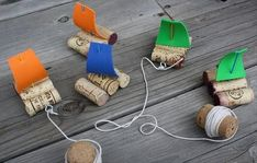 Cute sail boats made out of corks for pulling down the stream!!