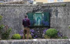 Visitor pays their respects at memorial built by locals in Tuam, on the site where 800 children were buried in mass graves.