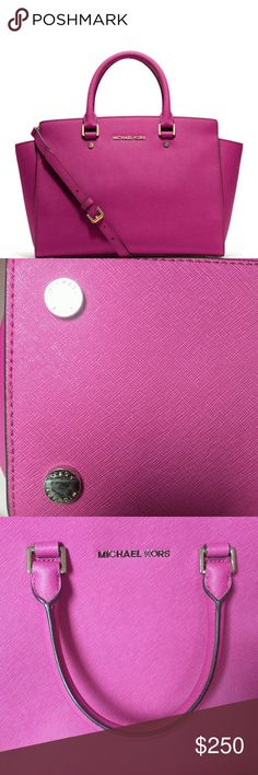 """Michael Kors Fuchsia Selma ? 100% Saffiano Leather? ? Silver-Tone Hardware? ? Approx. 13""""W x 9""""H x 5""""D? ? Handle Drop: 4.5""""? ? Adjustable Strap: 17.5""""-19.5""""? ? Interior Details: Zip Pocket, 2 Open Pockets? ? Lining: 100% Polyester? ? Top-Zip Fastening?  Minor marks as shown in pics. Dustbag included Michael Kors Bags Satchels"""