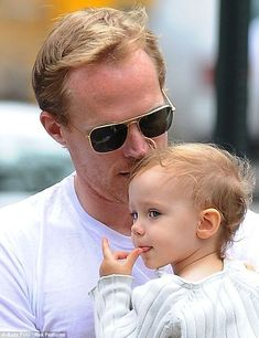 Paul Bettany,42 planting a tender kiss on his little girl's head.