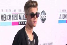 Justin Bieber's day in Miami court pushed back  #JustinBieber s day in court over a #dragracing incident in Miami Beach was pushed back, a court official said Thursday, as the teen idol used #Twitter to declare he s refocusing on his music. #Entertainment #News