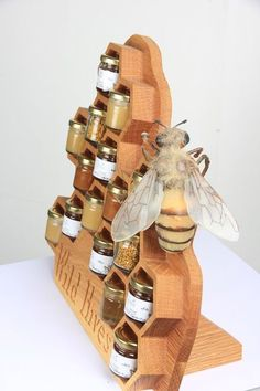 Unique prop for displaying jars of honey at a farmers' market, craft fair or in a retail shop.