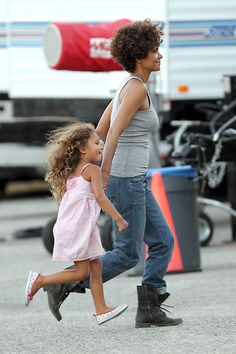 Play Time    Halle Berry and daughter Nahla run around while Halle takes a break from filming her new movie, The Hive, in Los Angeles on July 19.