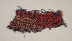 Fragment, 1400s  Germany, 15th century  patterned weave; wool, Overall - h:7.00 w:17.50 cm (h:2 3/4 w:6 7/8 inches). Gift of Mr. and Mrs. William J. Robertson 1985.197