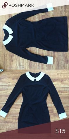 Black and white dress Cute, fitted black dress with white cap sleeves and white collar. Would be perfect for a Wednesday Adams costume :) Style Nanda Dresses Mini