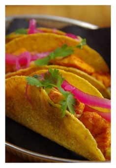 Salmon tacos with red onion pickles