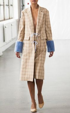 This **Saks Potts** Plaid Mink Cuff Coat features a standard lapel, long sleeves with contrast mink cuff detail, and exposed double front ties.