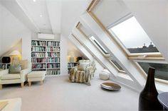 Attic conversion. Love the built in bookcases.